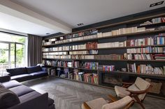Don't install incredibly long bookshelves unless you plan to meticulously curate the items on the shelves | MG's House by Zoom Architecture