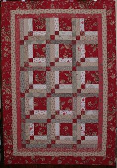 Quilt pattern is Upstairs and Downstairs, a log cabin variation, from the book Quilt Boutique by Suzanne McNeill. The fabric is Modas Rouenneries collection by the French General.