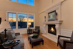 Who wouldn't be able to curl up in this room, next to the fireplace, and look out at the view all day?  Seattle, WA Coldwell Banker BAIN $3,495,000