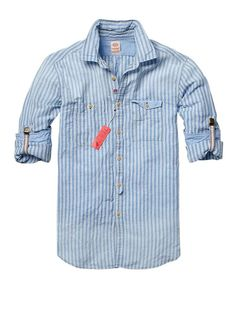 I really like the styling of this chambray shirt courtesy of Scotch & Soda. Styling the roll-ups after men's suspenders adds a cool, retro twist. ~s