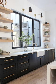 Love the sophisticated look of black kitchen cabinets with white oak floating shelves Black Kitchen Cabinets, Kitchen Renovation, Painted Kitchen Cabinets Colors, Beautiful Kitchen Cabinets, Home Decor Kitchen, Kitchen Interior, Interior Design Kitchen, Beautiful Kitchens, Kitchen Style