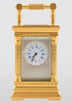 French mini carriage clock with corinthian gilt brass case, porcelain dial and silver dial mask, circa 1890. One year warranty.