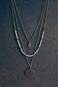 Welcome to Ananke Jewelry! This is a handmade boho style layered necklace. The shortest necklace has a little leaf pendant, another layer combined with beads and the longest one with round mandala pendant. Antique brass chains & findings. All the layers are connected to one clasp. If you wish to have it as a set of three necklaces, so you can wear each separately, just note it at checkout. A beautiful gift idea for any occasion…