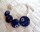 Chain bracelet with fabric button by ishalohalo in Etsy $12.00