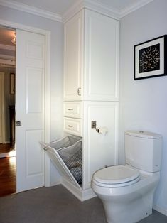 So genius. Hide your laundry hamper in specially-built cupboard space.