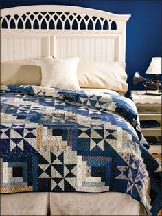 Collect your dark and light scraps to make a striking bed-size quilt with Log Cabin and Split Star blocks. This e-pattern was originally published in the June 2010 issue of Quilter's World magazine.