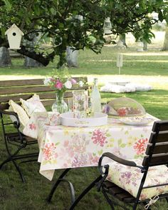 Windsor table, £425; Windsor bench, £400; Windsor chair, £195, Amelie seat pad, £20; Floral food cover, £15; Flower printed glass and tumblers set, £26; Melamine picnicware, from £4, all Laura Ashley.