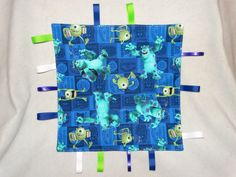 Hey, I found this really awesome Etsy listing at https://www.etsy.com/listing/219358870/tag-blanket-baby-shower-gift-monsters #monstersinc #tagblanket #babyblanket #babytoy #hayesbabycreations #ribbon #babyshowergift #giftideas #newbaby #teething