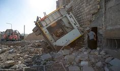 Destruction following an air strike in a rebel-held district of Aleppo on 23 September.