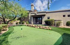 Gallery of golf backyard putting green ideas. See pictures of golf putting green designs to give you inspiration for creating your own home golfing space Cheap Landscaping Ideas, Landscaping With Rocks, Backyard Landscaping, Backyard Ideas, Backyard Patio, Backyard Putting Green, Large Backyard, Sloped Backyard, Backyard Furniture