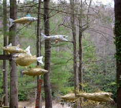 the Recycled art of John D. Richards. This amazing Flying Alumifish Mobile was created using cat food can lids, the business end of a burned out light bulb, glass globs, galvanized wire and ordinary box staples. Link has great photos of work in progress.