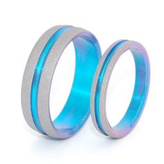 Magical Set. This beautifully crafted, titanium wedding ring set has a sandblasted finish. Bright turquoise interior and groove anodization. Pictured at 3.5mm and 6.4mm.