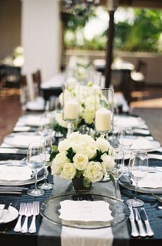 Classic Rose Centerpieces + Candles: http://www.StyleMePretty.com/2014/03/20/classic-white-wedding-at-bacara-resort/ Patrick Moyer Photography on #SMP