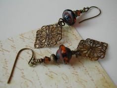 Dark Toffee Picasso Czech Faceted Saturn, Swarovski Crystal and Filigree Earrings, via Etsy.
