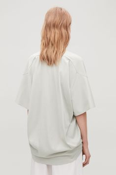 Cut with a circular shape, this cotton-jersey T-shirt has a relaxed and modern feel. Designed to sit loosely on the body, it has short sleeves, a round neck and minimal seam finishes. Back length of size S is / Model is tall and wearing a size 6 Cos Shirt, Cos Tops, White Shirts, Active Wear, Bell Sleeve Top, Women Wear, Short Sleeves, Man Shop, T Shirts For Women