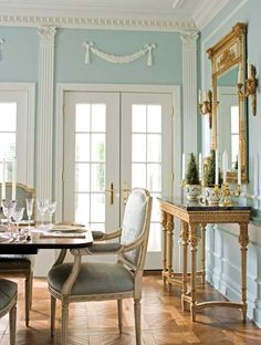 Robin's egg blue and gold make an elegant pair in this formal dining room. - Traditional Home®  Photo: John Bessler Design: Eric Lysdahl