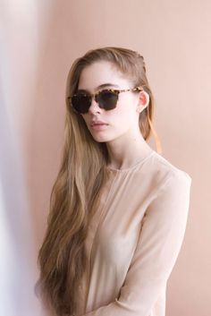 Soft look with long hair and sunglasses.