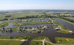 Blauwestad, the Netherlands. Boerenland omgezet in woningen plus bijbehorend water en recreatiegebied.