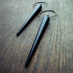 Hey, I found this really awesome Etsy listing at http://www.etsy.com/listing/112816430/huge-black-spike-earrings-edgy-goth-soft