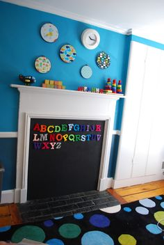 kid proof the fireplace with a magnetic chalkboard - painted on custom fit wood piece