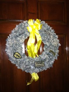 My version of a deployment wreath. I made it with my son's Army uniform and patches like the ones he is wearing in Afghanistan.