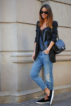 leather top with lace details, baggy jeans, flats, a plain black blazer and Chanel bag.
