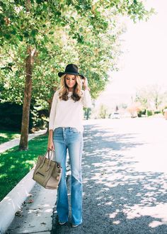 We're digging this 70's vibe! Stay on-trend this season in a pair of flare jeans.