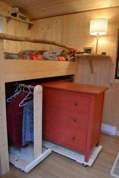Closet under bed!  Dresser on rollers!