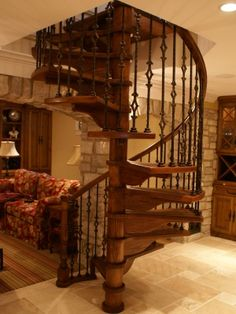 Uniuqe spiral stair case with Iron balusters . Done by our sister company Fox Valley Stair.
