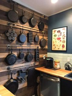 Finished the wood wall for my wife's cast iron (now just gotta remove those damn stickers) - woodworking Rustic Kitchen, Diy Kitchen, Kitchen Decor, Kitchen Organization, Kitchen Storage, Iron Storage, Cast Iron Cookware, Iron Wall, Cuisines Design