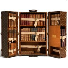 Louie Vuitton's 1923 bookcase trunk. (Ernest Hemingway had one)  [Must have weighed a ton]