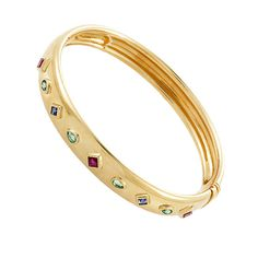 Cartier Precious Gemstone Yellow Gold Bangle Bracelet. Adorn yourself with luxury as you don this gorgeous bangle bracelet from Cartier. The bracelet is made of 18K yellow gold and is studded with two diamond-shaped sapphires, four pear-shaped emeralds, and three diamond-shaped rubies. 20th century