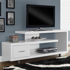 ***FREE SHIPPING*** Like a piece of art right in your living room, this White Modern TV Stand - Fits up to 60-inch Flat Screen TV is just as beautiful as it is functional. This art-deco inspired TV co