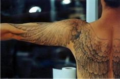 Wings are fine. Going down the arm, however, is very nice. I've always thought this is the way wing tattoos should be done.