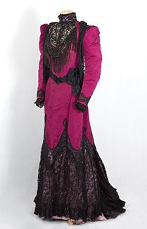 Worth beaded silk faille dress, c.1890. From the celebrated House of Worth when Charles Worth was alive, the grand gown is offered below market because it needs work. With an arresting magenta-black color combination, the magnificent dress could be the focal point of your collection. The magenta silk faille is in excellent durable condition. The brilliant dress is trimmed with black lace, black jet beads, and black satin ribbon.