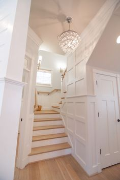 Staircase with gorgeous woodwork - A Beach House Built Near the Ocean in Norfolk Virginia