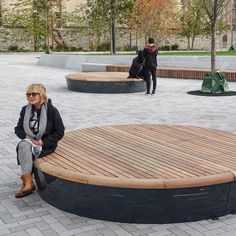 The Solid Podium Discs are circular platforms that serve as playful seating elements. The Discs feature a Solid slatted structure in multi-coloured hardwood with a red-brown colour. Diy Furniture Renovation, Diy Furniture Cheap, Diy Furniture Hacks, Urban Furniture, Street Furniture, Garden Furniture, Furniture Legs, Barbie Furniture, Furniture Design