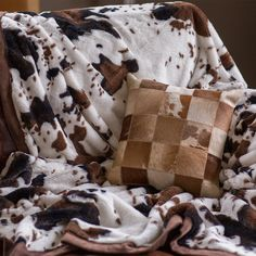 Looking for a place to hide from the cold? Try getting under this cowhide-style blanket.