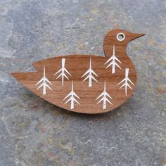 This pretty gull brooch has been cut from cherry wood and engraved with an original hand-drawn design inspired by Scandinavian patterns, then hand-painted.The brooch comes boxed and presented on a specially designed gift card, making it a great pr...