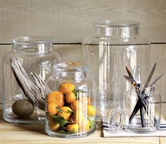 i like this mix of clear glass jars that are both useful and pretty.  they could be really great for a bathroom or kitchen.