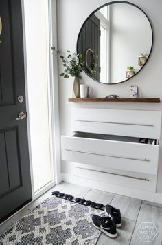 DIY Split Level Entry Makeover- I LOVE this entry. The oversize door, scandi influence and that shoe storage! DIY Split Level Entry Makeover- I LOVE this entry. The oversize door, scandi influence and that shoe storage! Entryway Shoe Storage, Diy Shoe Storage, Entryway Organization, Small Storage, Entryway Decor, Entryway Ideas, Narrow Entryway, Hallway Ideas, Ikea Storage