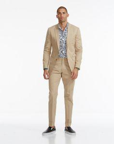 How to Wear a Khaki Suit Photos | GQ | Simple Shoe + Exotic Shirt