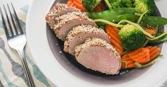 This is a great, easy, and delicious pork tenderloin recipe that's made with a simple marinade of soy sauce, sesame oil, garlic, and ginger and then cooked with a sweet and savory crust of honey and...