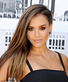 """Beautiful Jessica Alba with side swept hairstyle at the """"Sin City: A Dame to Kill For"""" panel during Comic-Con International 2014."""