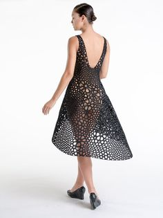 The Kinematics dress, created by generative design studio Nervous System, is, in all cliches, no. 3d Printed Fabric, Mode 3d, Define Fashion, New York Museums, Wearable Technology, Future Fashion, Sweater Design, Dress Backs, Nervous System