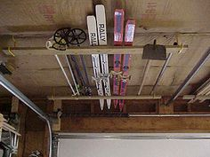 Super simple and cheap (Dollar store items) overhead storage for millwork and ot. Super simple and cheap (Dollar store items) overhead storage for millwork and other long/thin objec Garage Storage Solutions, Diy Garage Storage, Garage Shelving, Shop Storage, Storage Ideas, Loft Storage, Workshop Organization, Garage Organization, Basic Carpentry Tools