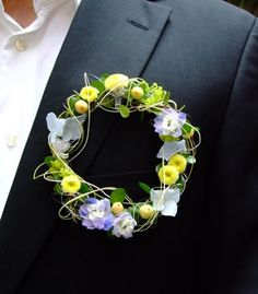 A very interesting circular 'buttonhole'. Loved by Jemini Flowers, Oxford - www.jemini.co.uk