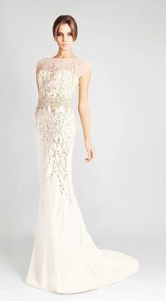 Georges Hobeika white and gold gown. It looks like a gold forest is trying to overtake the snowy white gown.
