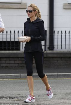 Fitness fanatic: Abbey Crouch revealed the secret to her slimline frame, as she was spotted walking around Alderley Edge in tight black gym gear on Monday