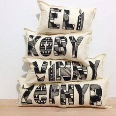 Monochrome kids room decor. Personalised cushions by Miles & Tate